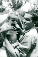 """Actor Alain Delon with his son Anthony during the filming of the movie """"Commandos"""""""