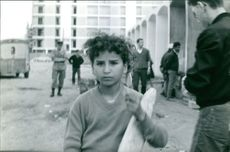 A child holding a piece of bread.