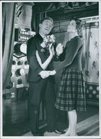 A scene from the film Bara en kypare (Only a waiter) with Nils Poppe as Fabian Bom Waiter and Marianne Bengtsson as Annie Olsson, 1959.