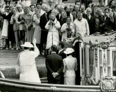 """Queen Margrethe of Denmark, King Carl XVI Gustaf and Queen Silvia on board """"Vasaorden"""" at Riddarholmen in front of a crowd of spectators"""
