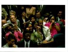 Members of OJ Simpson's family react as the not guilty verdict.
