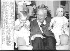 England's Prime Minister Harold Wilson with the grandchild, twins Jennifer and Catherine
