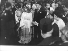 Lamia Solh and her husband Prince Moulay Abdallah of Morocco standing with people