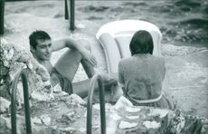 A man and a woman relaxing after having bath.