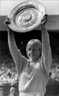 Martina Navratilova proudly holds his trophy after winning the Wimbledon Championship