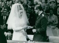 Princess Margriet and Prince Pieter van Vollenhoven saying their vows to each other.