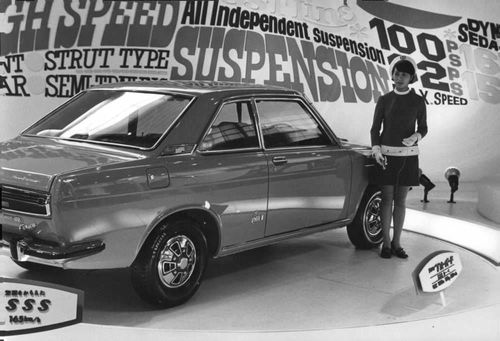 Woman standing by brand new car of Honda.
