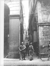 Soldiers standing on the street, during the war in Algeria.