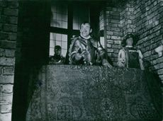 A vintage photo of Nils Poppe in an acting scene during his career in theater acting.