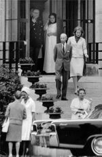 Princess Irene talking to a guest before leaving with her mother Queen Juliana of the Netherlands.