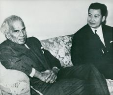 India's Krishna Menon and Cambodian Prince Norodom Sihanouk take a break for a conference