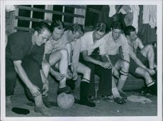 Footballers wearing shoes and getting ready for the football Olympic, 1939.