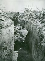 Soldiers covering themselves in trenches during war.  Taken - Mar. 1969