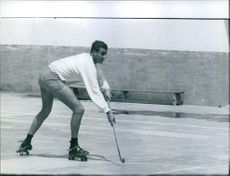 Don Juan Carlos de Bourbon, King of Spain, playing roller hockey. 1959.