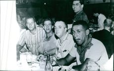 Men dining and drinking together.  - May 1970