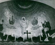 THIS MOSAIC FIXED IN THE WALL OF THE FRANCISCAN CHAPEL ON TABOR PORTRAYS A STORY.