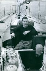 A man sailing on hi boat. 1964.