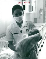A nurse carrying baby of Princess Maria Gabriella.