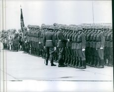 Soldiers standing in street during an event.