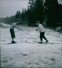 Englishmen skiing on ice, Sweden, 1945.
