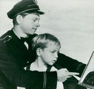 """Mickey Rooney and Jock Jenkins in the movie """"We People"""" - Year 1943"""