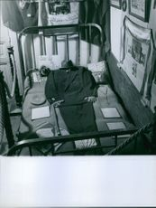 Clothes being placed on bed like a man lying on bed.