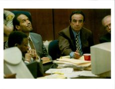 Defendant OJ Simpson reacts to a picture on computer monitor.