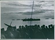 A convoy of reinforcements approaches the North African coast.