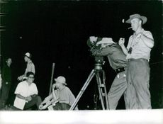 Photographers taking pictures during the night in Saigon.