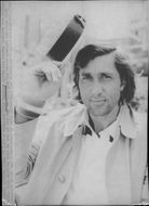 Ilie Nastase outside his hotel in London on his way to the continuation of the Wimbledon match against Dick Stockton interrupted due to rain