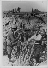Soldiers on a wreckage area in Finland.  - 1942