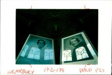 Lord Daventry's Sisters reflect some classic windows in Arbury Hall.