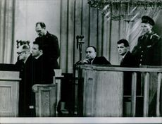 Francis Gary Powers with other men testifying in a court trial, 1960.