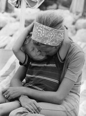 Prince Laurent of Belgium as kid, kissing his mother