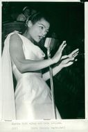 Eartha Kitt on stage in beautiful light dress