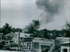 Smoke come out from a house in cholon area of Saigon, Vietnam.  Vietnam War.