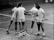 Tennis player J. Codes and T. Forge double against A. Pannatta and Ilie Nastase