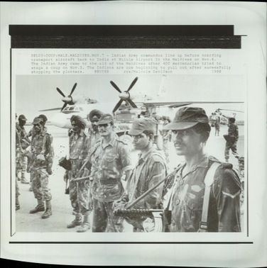 Indian Army commandos line up before boarding transport aircraft.