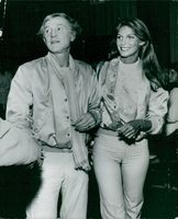 Richard Harris and Ann Turkel arrive at a Hollywood party