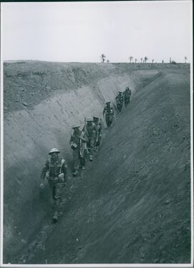 Men of the East Yorks making their way along an Anti-tank ditch.  - 1943