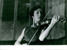 Claire Bernard playing the violin.