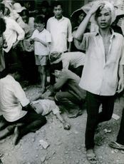 A vintage photo of Vietnam citizens were in shocked brought about by the crisis in their land.