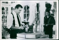 Kevin Costner and Christopher Birt in a scene from the movie The Bodyguard.