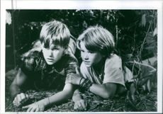 """Brad Renfro and David Speck together in forest as one of the scenes from the american thriller movie, """"The Client""""."""