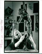 Andrew Edwards works on a Figure of Sculpture
