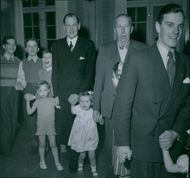 Karl Lemmel, Wilhelm Lindencrona and Stig Gahr in the dance swirls with the children at the traditional cadet fair at Karlberg. - 3 January 1948