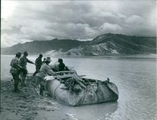 1962  Soldiers standing and boarding on the boat to go somewhere.