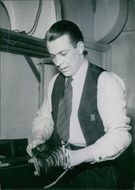 Arne Andersson of the AIK photographed polishing his shoes. 1944.