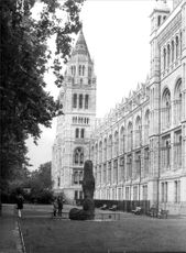A black and white photograph on the exterior of the Natural History Museum in London.