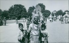 People in costume parading and dancing on the street during the wedding of King Birendra and Queen Aishwarya of Nepal, 1970.